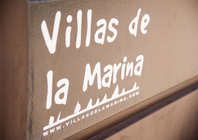 Logo of Villa de la Marina on outside gates